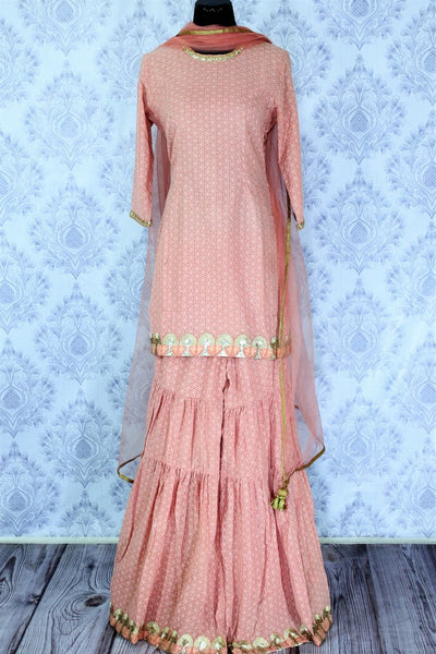Beautiful pastel pink embroidered sharara suit with dupatta for online shopping in USA. A beautiful choice for an ethnic Indian look at special occasions. Add latest Indian designer suits to your ethnic wardrobe available at Pure Elegance Clothing store in USA for women.-full view