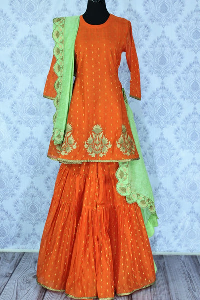 Bright orange embroidered sharara suit with dupatta for online shopping in USA. A beautiful choice for a striking ethnic Indian look at special occasions. Add latest Indian designer dresses to your ethnic wardrobe available at Pure Elegance Clothing store in USA for women.-full view