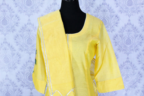 Lemon yellow embroidered sharara suit with dupatta buy online in USA. A beautiful choice for a striking ethnic Indian look at special occasions. Add latest Indian designer dresses to your ethnic wardrobe available at Pure Elegance Clothing store in USA for women.-front