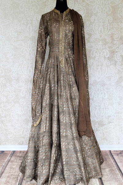 Buy brown printed tussar silk floor length Anarkali suit online in USA with dupatta. The elegant suit is perfect for a classic Indian ethnic look. Make your Indian clothing collection exquisite with beautiful Indian designer Anarkali suits available at Pure Elegance clothing store in USA or shop online.-full view