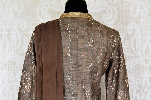 Buy brown printed tussar silk floor length Anarkali suit online in USA with dupatta. The elegant suit is perfect for a classic Indian ethnic look. Make your Indian clothing collection exquisite with beautiful Indian designer Anarkali suits available at Pure Elegance clothing store in USA or shop online.-suit back