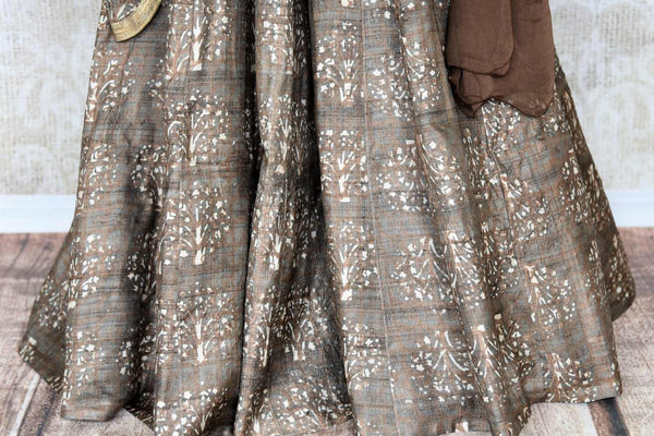 Buy brown printed tussar silk floor length Anarkali suit online in USA with dupatta. The elegant suit is perfect for a classic Indian ethnic look. Make your Indian clothing collection exquisite with beautiful Indian designer Anarkali suits available at Pure Elegance clothing store in USA or shop online.-suit bottom