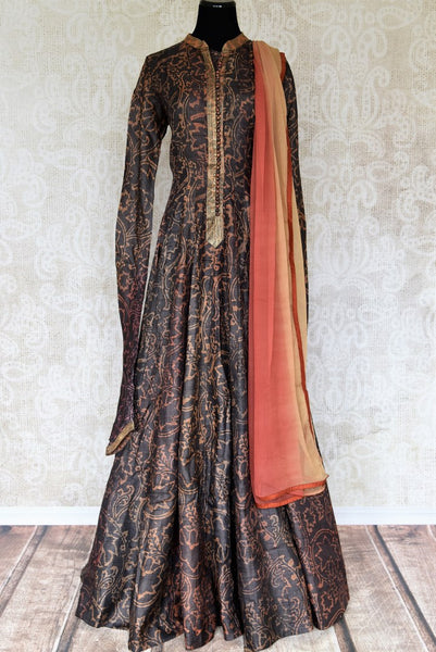 Buy dark brown printed tussar silk floor length Anarkali suit online in USA with dupatta. The elegant suit is perfect for a classic Indian ethnic look. Make your Indian clothing collection exquisite with beautiful Indian Anarkali suits available at Pure Elegance clothing store in USA or shop online.-full view
