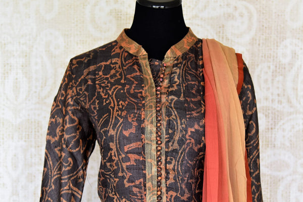 Buy dark brown printed tussar silk floor length Anarkali suit online in USA with dupatta. The elegant suit is perfect for a classic Indian ethnic look. Make your Indian clothing collection exquisite with beautiful Indian Anarkali suits available at Pure Elegance clothing store in USA or shop online.-suit front