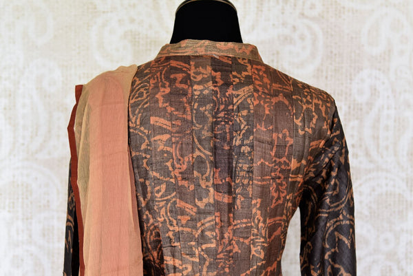 Buy dark brown printed tussar silk floor length Anarkali suit online in USA with dupatta. The elegant suit is perfect for a classic Indian ethnic look. Make your Indian clothing collection exquisite with beautiful Indian Anarkali suits available at Pure Elegance clothing store in USA or shop online.-suit back
