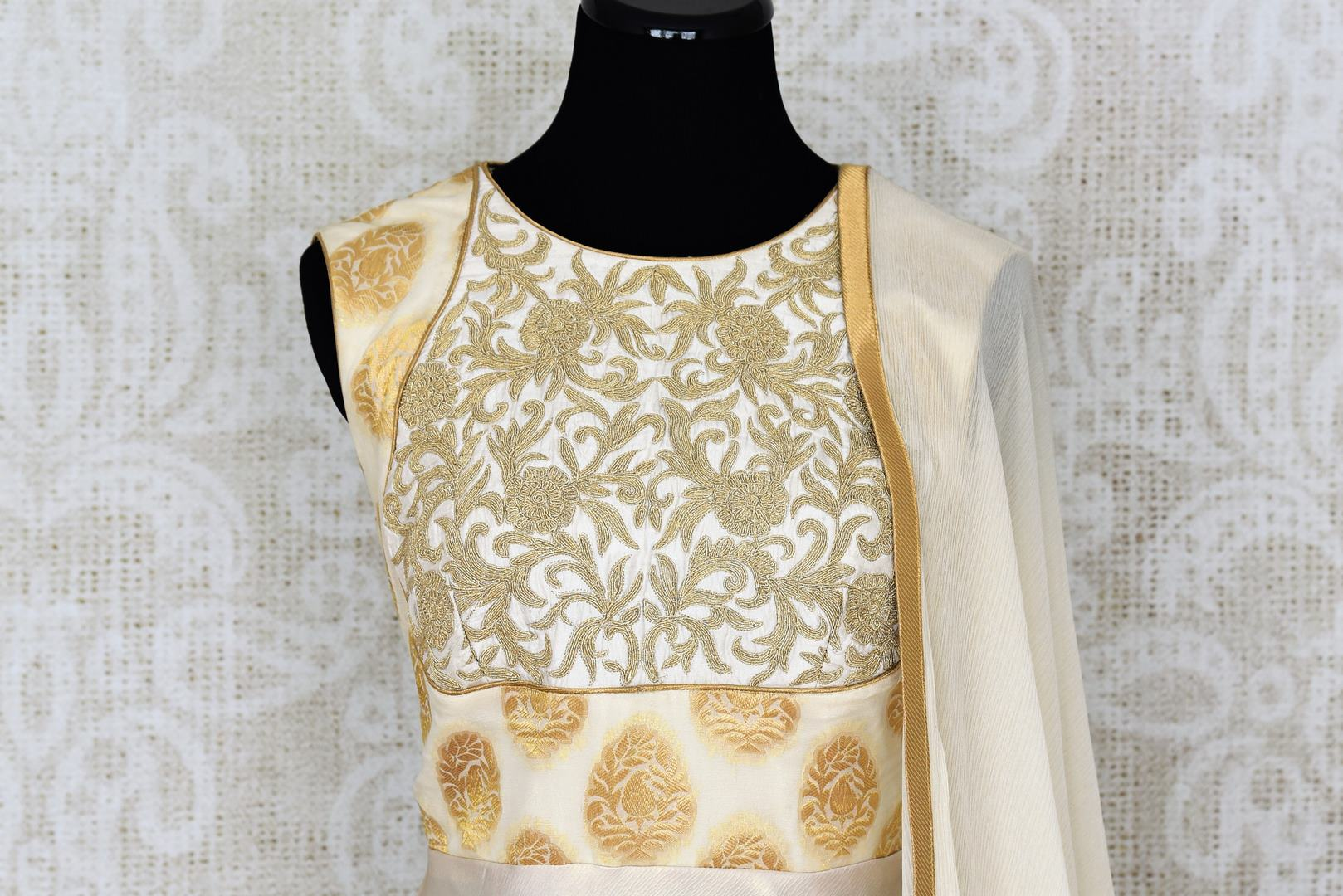 Buy classy off-white embroidered Banarasi silk suit with dupatta online in USA. Add brilliance to your Indian look with an exquisite range of designer dresses, Anarkali suits available at Pure Elegance exclusive clothing store in USA or shop online.-top front