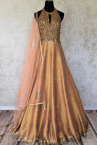 Leave them gaping in awe as you strut in this scintillating gold silk floor-length dress. The sequins embroidered on the dress complemented with a halter neck and peach sequin work dupatta looks spectacular Shop designer anarkali suits, concept sarees, indowestern dresses online or visit Pure Elegance store, USA. -full view