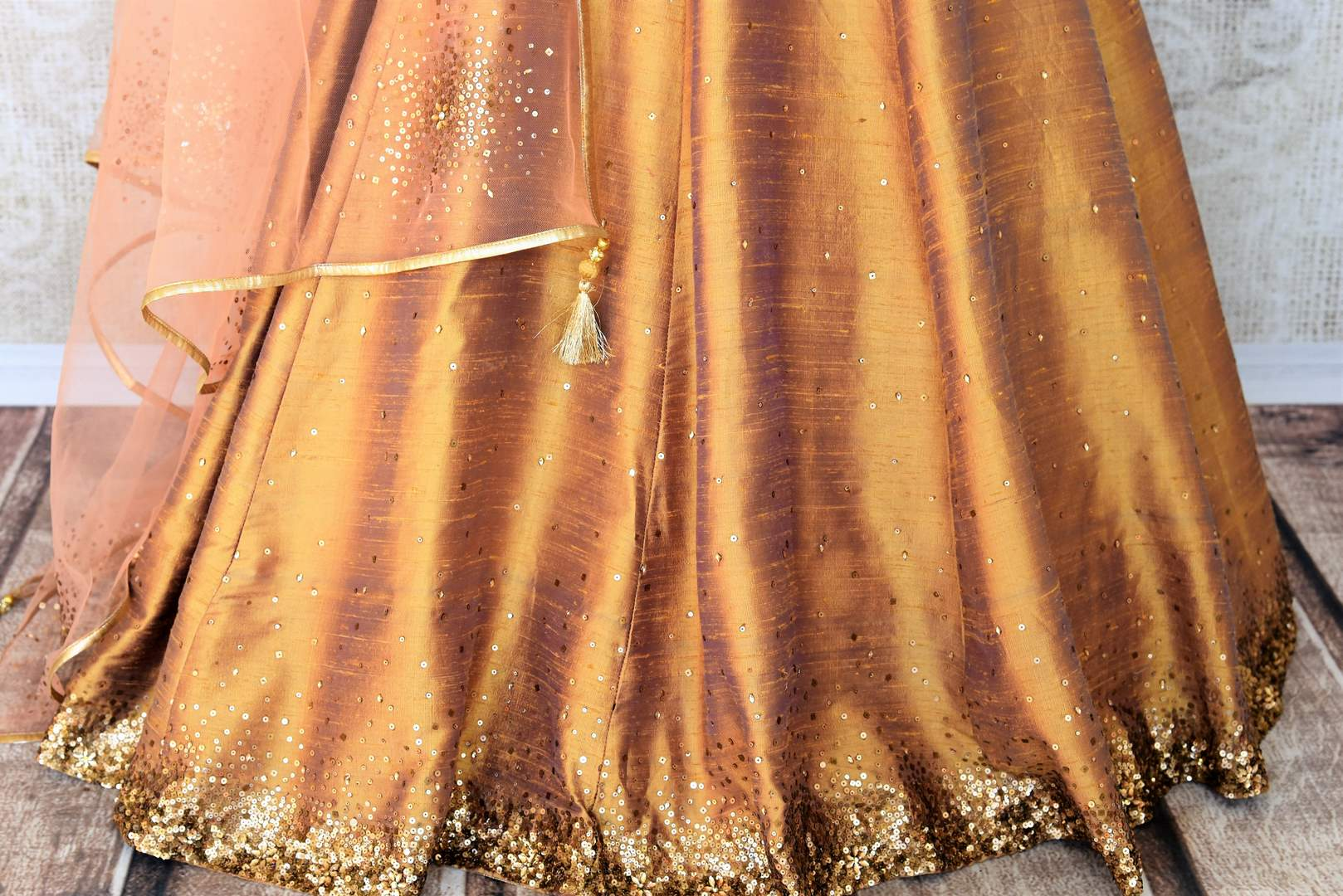 Leave them gaping in awe as you strut in this scintillating gold silk floor-length dress. The sequins embroidered on the dress complemented with a halter neck and peach sequin work dupatta looks spectacular Shop designer anarkali suits, concept sarees, indowestern dresses online or visit Pure Elegance store, USA. -pleats