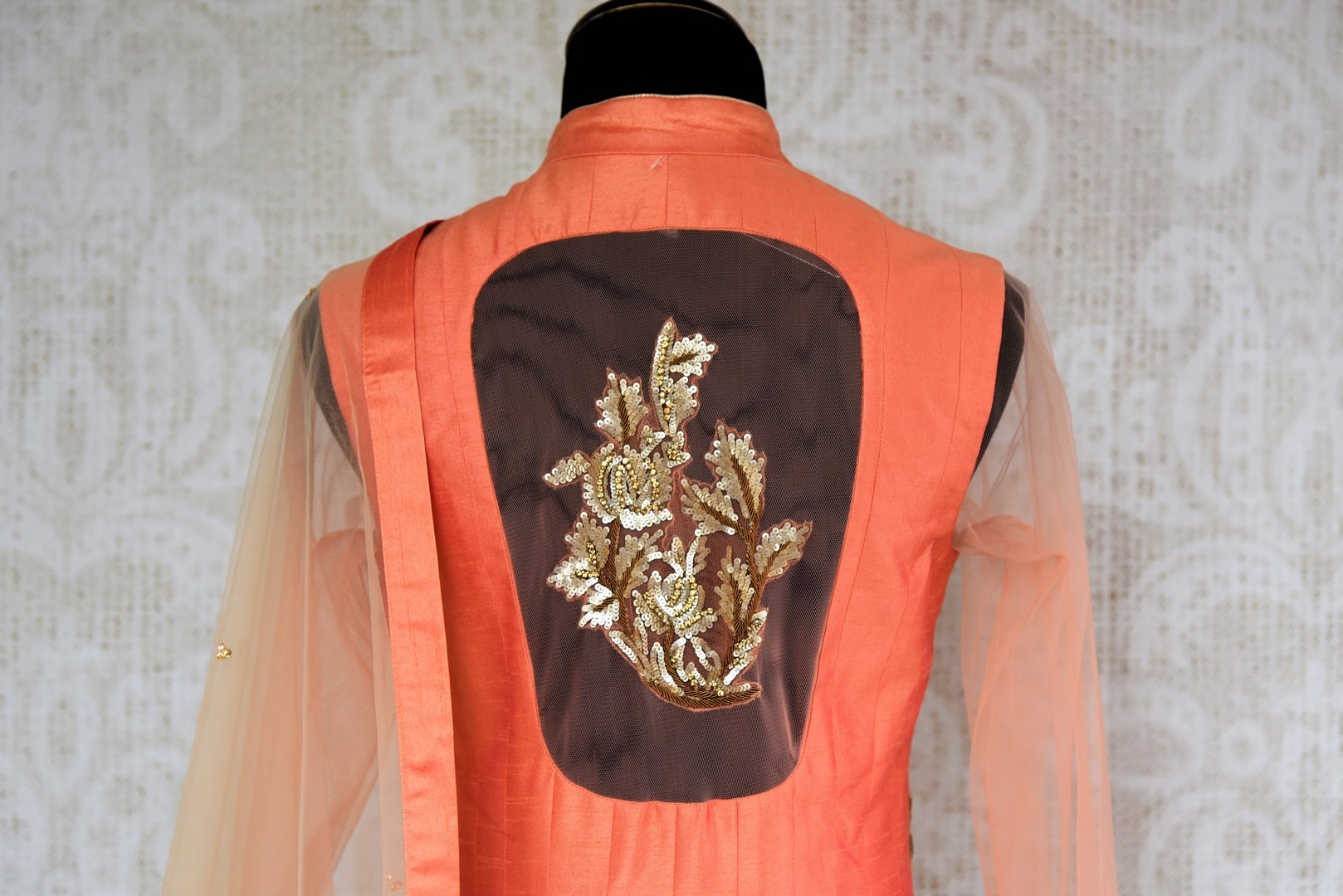 Beautifully embroidered peach gotta patti handwoven kurta with silk skirt and dupatta is modern fused into traditional lehenga. Apt for weddings, parties and special occasions, the gorgeous threadwork on the back and front makes it all the more enticing. Buy online or visit the Pure Elegance store in USA.- full view