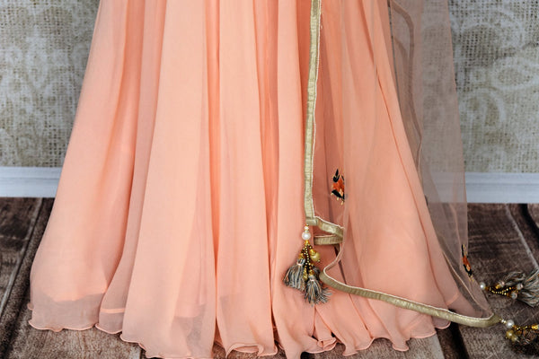 Buy peach embroidered floor length Anarkali suit online in USA with dupatta. Make your Indian clothing collection exquisite with beautiful Indian designer dresses, Anarkali suits available at Pure Elegance clothing store in USA or shop online.-bottom