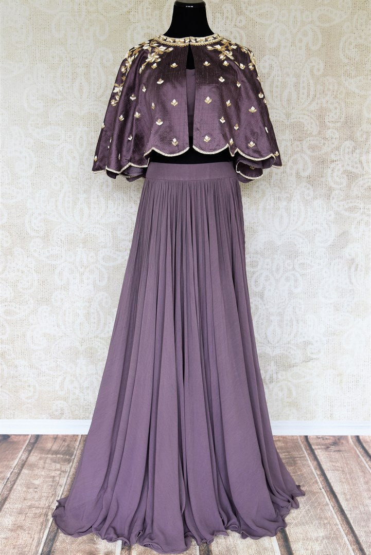 Buy lilac pearl embroidery raw silk cape style top with skirt online in USA. Make your Indian clothing collection exquisite with beautiful Indian designer dresses, Indowestern dresses available at Pure Elegance clothing store in USA or shop online.-full view