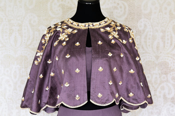 Buy lilac pearl embroidery raw silk cape style top with skirt online in USA. Make your Indian clothing collection exquisite with beautiful Indian designer dresses, Indowestern dresses available at Pure Elegance clothing store in USA or shop online.-top front