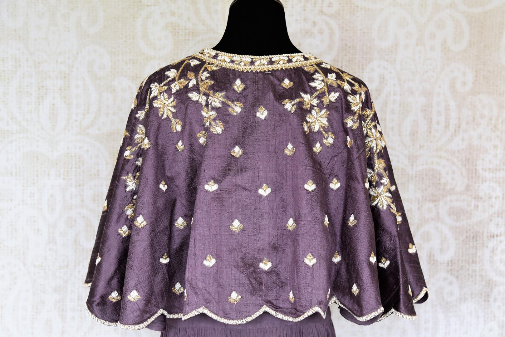 Buy lilac pearl embroidery raw silk cape style top with skirt online in USA. Make your Indian clothing collection exquisite with beautiful Indian designer dresses, Indowestern dresses available at Pure Elegance clothing store in USA or shop online.-top back
