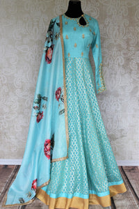 Dress to impress in this beautiful blue chanderi silk floor-length Anarkali suit. It comes with a pretty feminine floral blue dupatta to add a touch of elegance. The gorgeous buta embroidery looks ethereal. Shop authentic silk designer dresses, lehenga skirts and banarsi saris online or visit Pure Elegance store, USA. -full view