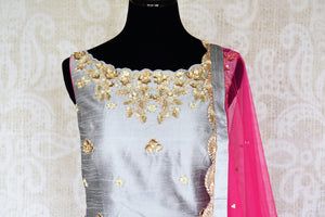 Be a muse in this pretty ash grey silk embroidered designer shararas with a dazzling grey embroidered kurta. The stunning zari embroidery coupled with a contrasting pink embellished dupatta with tassels hanging on its corners looks heavenly. Shop such beautiful Indian dresses, lehengas online or visit Pure Elegance store, USA. -suit front