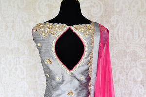 Be a muse in this pretty ash grey silk embroidered designer shararas with a dazzling grey embroidered kurta. The stunning zari embroidery coupled with a contrasting pink embellished dupatta with tassels hanging on its corners looks heavenly. Shop such beautiful Indian dresses, lehengas online or visit Pure Elegance store, USA. -suit back