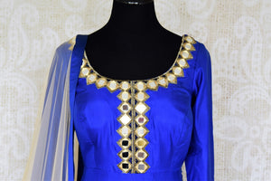 Slay effortlessly in this electric blue silk mirror work embroidered Anarkali suit with beige sheer net dupatta. The gorgeous embroidery on the border of dupatta and gold zari border on the hem of the suit looks scintillating. Shop beautiful Indian dresses, suits, sarees online or visit Pure Elegance store, USA. -suit front
