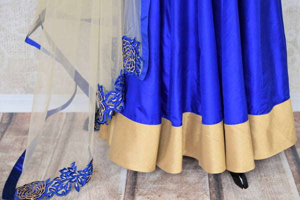 Slay effortlessly in this electric blue silk mirror work embroidered Anarkali suit with beige sheer net dupatta. The gorgeous embroidery on the border of dupatta and gold zari border on the hem of the suit looks scintillating. Shop beautiful Indian dresses, suits, sarees online or visit Pure Elegance store, USA. -suit bottom