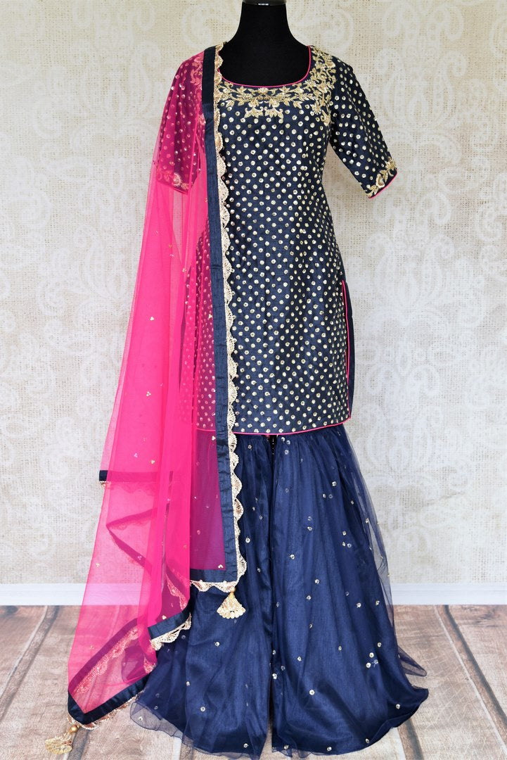 The Bollywood-inspired black raw silk embellished sharara with blue embroidered kurta is your go-to for weddings, festivals and family gatherings. Complete the look with a contrasting pink embellished sheer dupatta. Shop beautiful Indian designer dresses, suits, lehengas, online or visit Pure Elegance store, USA. -full view