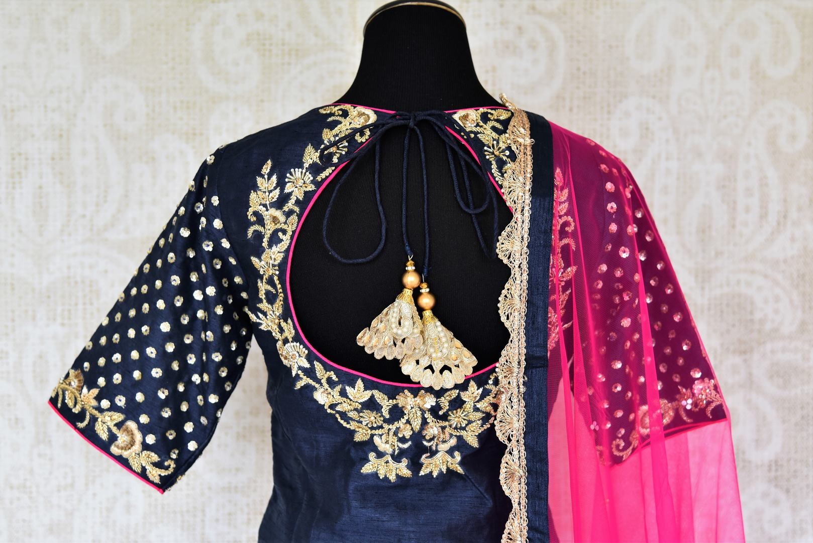 The Bollywood-inspired black raw silk embellished sharara with blue embroidered kurta is your go-to for weddings, festivals and family gatherings. Complete the look with a contrasting pink embellished sheer dupatta. Shop beautiful Indian designer dresses, suits, lehengas, online or visit Pure Elegance store, USA. -suit back