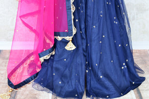 The Bollywood-inspired black raw silk embellished sharara with blue embroidered kurta is your go-to for weddings, festivals and family gatherings. Complete the look with a contrasting pink embellished sheer dupatta. Shop beautiful Indian designer dresses, suits, lehengas, online or visit Pure Elegance store, USA. -sharara bottom