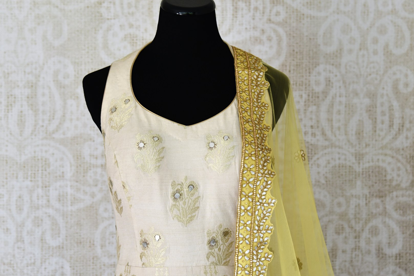 Buy white gota patti embroidery muga Banarasi suit with dupatta online in USA. Adorn your style with a range of exquisite Kanchipuram silk saris from Pure Elegance clothing store in USA. We have an exquisite range of Indian designer sarees, silk sarees, Banarasi saris and many other varieties also available at our online store.-front
