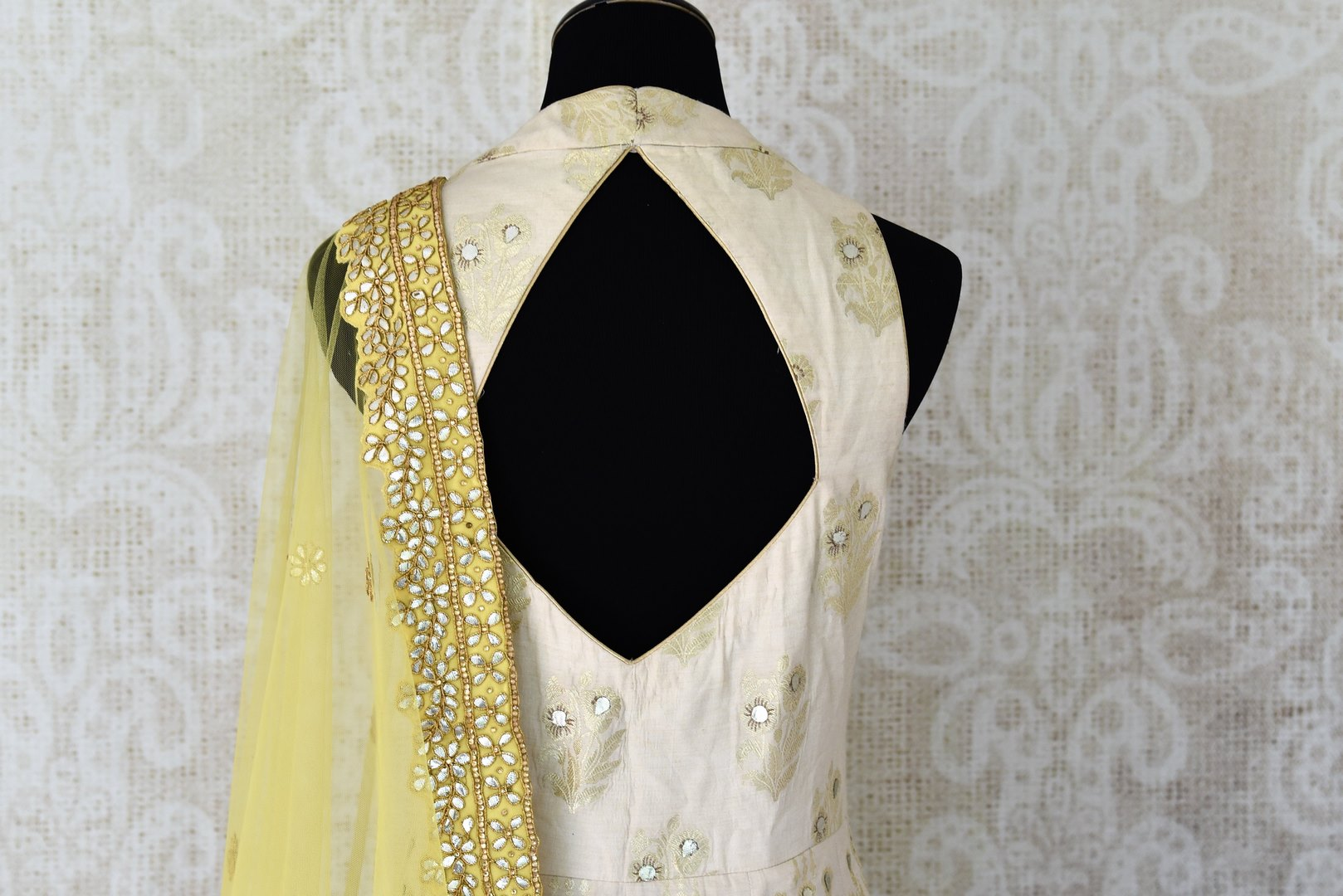 Buy white gota patti embroidery muga Banarasi suit with dupatta online in USA. Adorn your style with a range of exquisite Kanchipuram silk saris from Pure Elegance clothing store in USA. We have an exquisite range of Indian designer sarees, silk sarees, Banarasi saris and many other varieties also available at our online store.-back