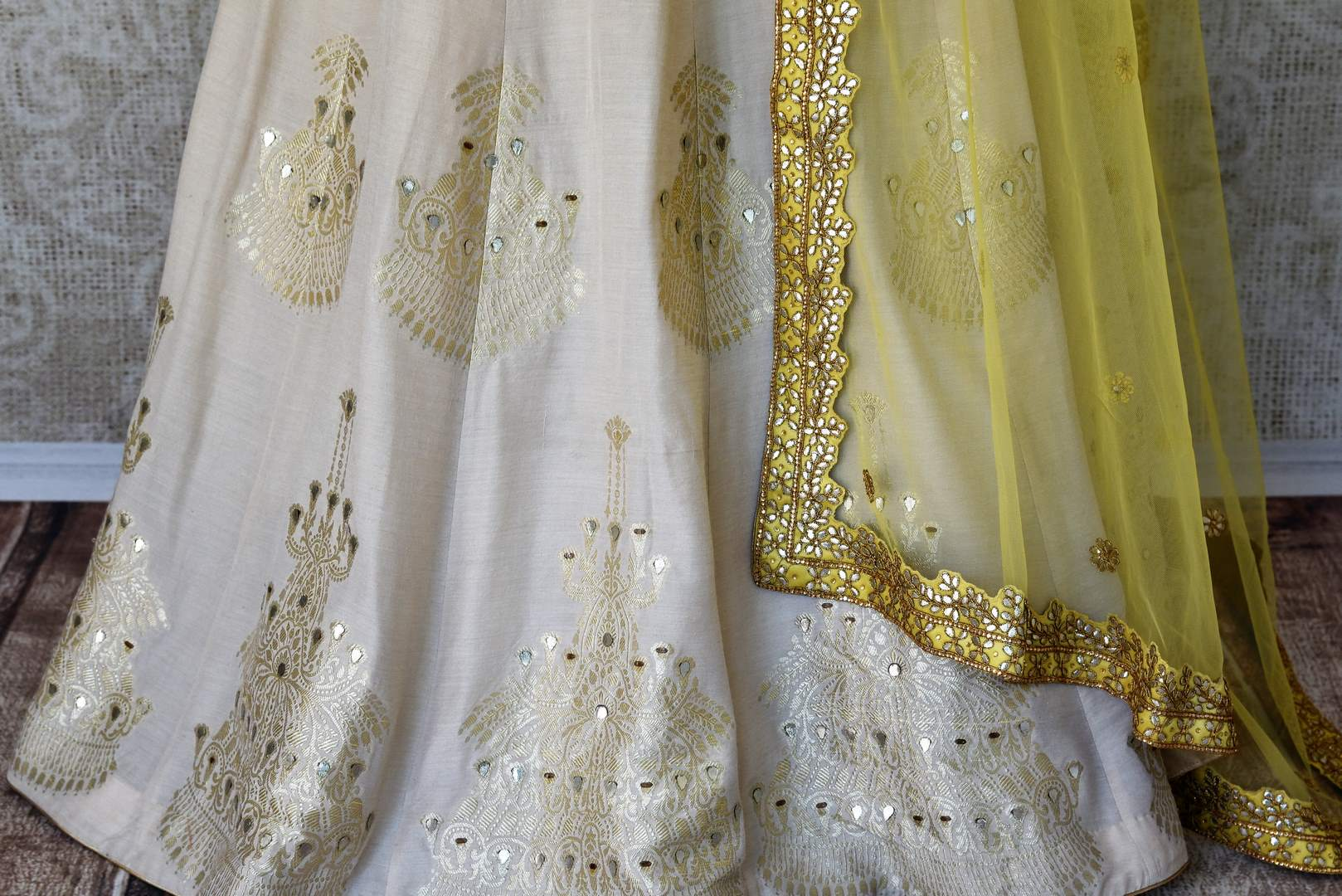 Buy white gota patti embroidery muga Banarasi suit with dupatta online in USA. Adorn your style with a range of exquisite Kanchipuram silk saris from Pure Elegance clothing store in USA. We have an exquisite range of Indian designer sarees, silk sarees, Banarasi saris and many other varieties also available at our online store.-skirt