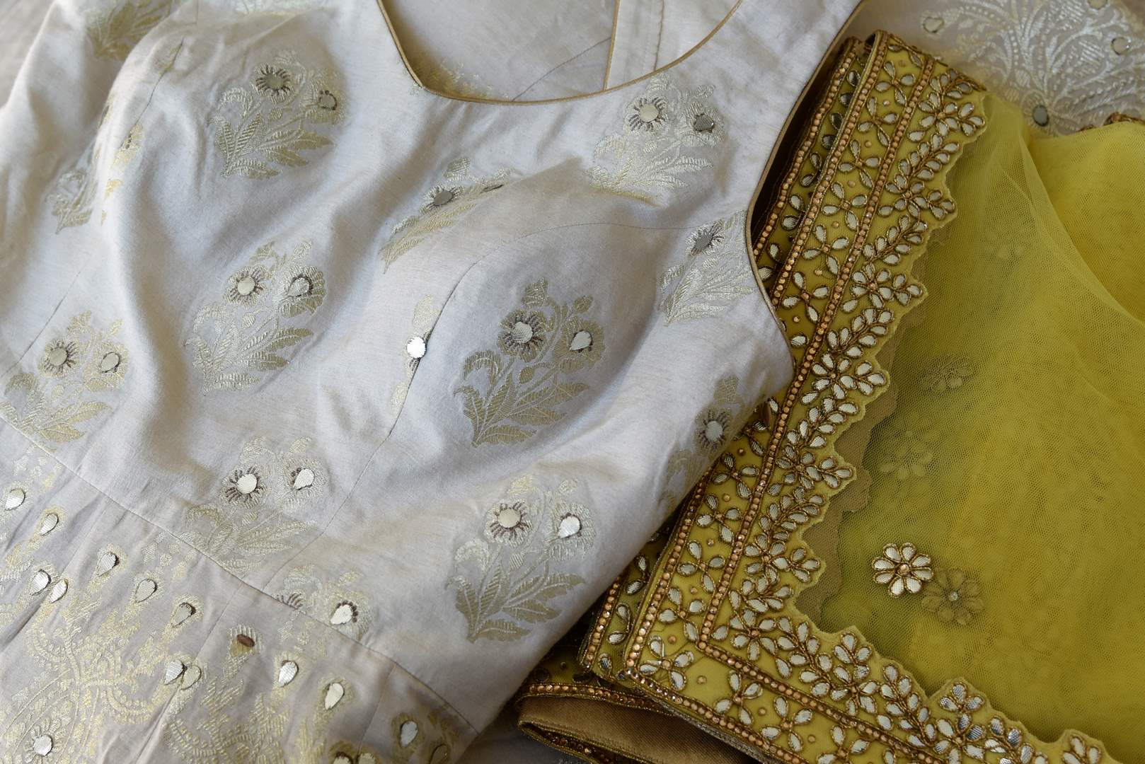 Buy white gota patti embroidery muga Banarasi suit with dupatta online in USA. Adorn your style with a range of exquisite Kanchipuram silk saris from Pure Elegance clothing store in USA. We have an exquisite range of Indian designer sarees, silk sarees, Banarasi saris and many other varieties also available at our online store.-details