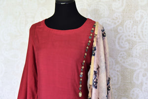 Shop maroon chanderi silk dress online in USA with printed dupatta. If you are fond of Indian fashion then you must visit Pure Elegance Indian clothing store in USA. We have a splendid collection of Indian designer dresses, Indowestern dresses and clothing here for you on our shelves. -side view