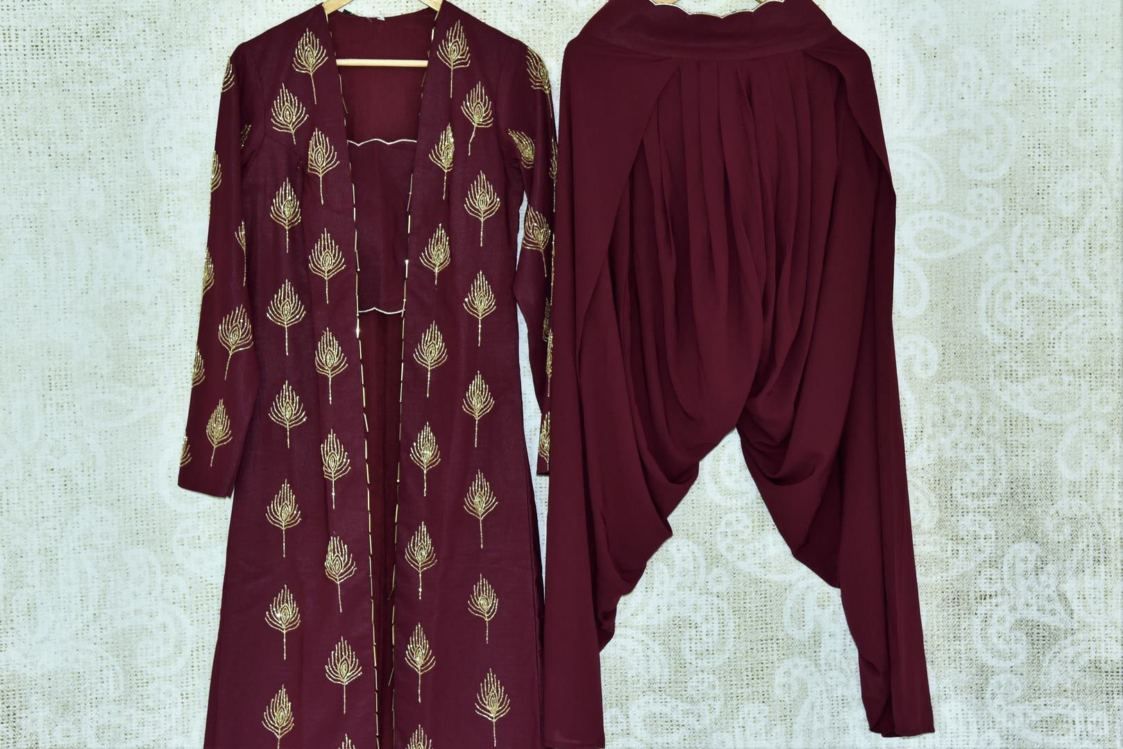 Buy wine color georgette suit with hand embroidery online in USA. If you are fond of Indian fashion then you must visit Pure Elegance Indian clothing store in USA. We have a splendid collection of Indian designer dresses, Indowestern dresses and clothing here for you on our shelves. -full view