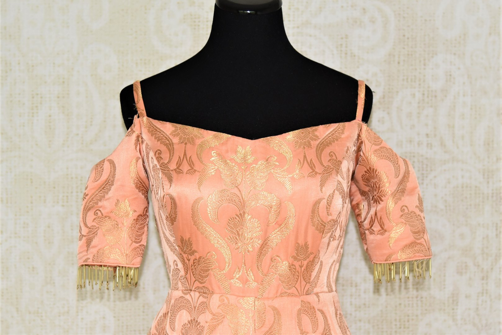 Buy beautiful peach Banarasi silk designer gown online in USA. Add brilliance to your Indian look with alluring Indian designer wedding dresses available at Pure Elegance Indian clothing store for women in USA or shop online.-front