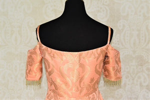 Buy beautiful peach Banarasi silk designer gown online in USA. Add brilliance to your Indian look with alluring Indian designer wedding dresses available at Pure Elegance Indian clothing store for women in USA or shop online.-back