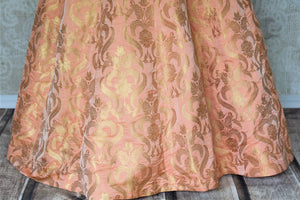 Buy beautiful peach Banarasi silk designer gown online in USA. Add brilliance to your Indian look with alluring Indian designer wedding dresses available at Pure Elegance Indian clothing store for women in USA or shop online.-panel