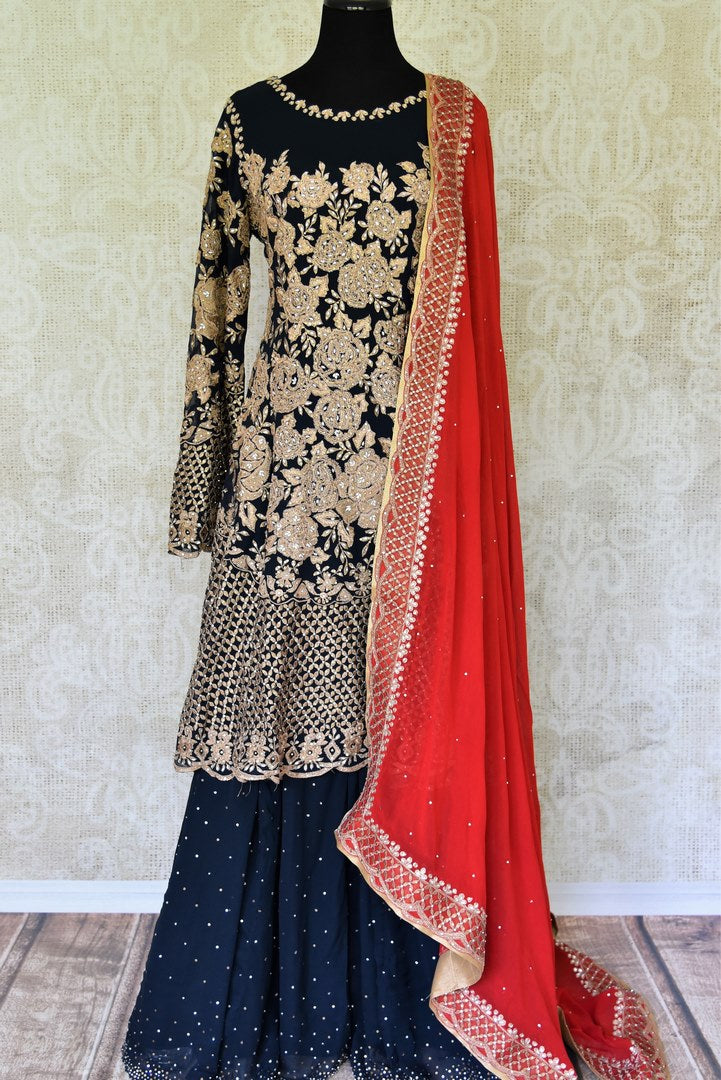 Buy beautiful black embroidered georgette suit online in USA with dupatta. If you are fond of Indian fashion then you must visit Pure Elegance Indian clothing store in USA. We have a splendid collection of Indian designer dresses, Indowestern dresses and clothing here for you on our shelves. -full view