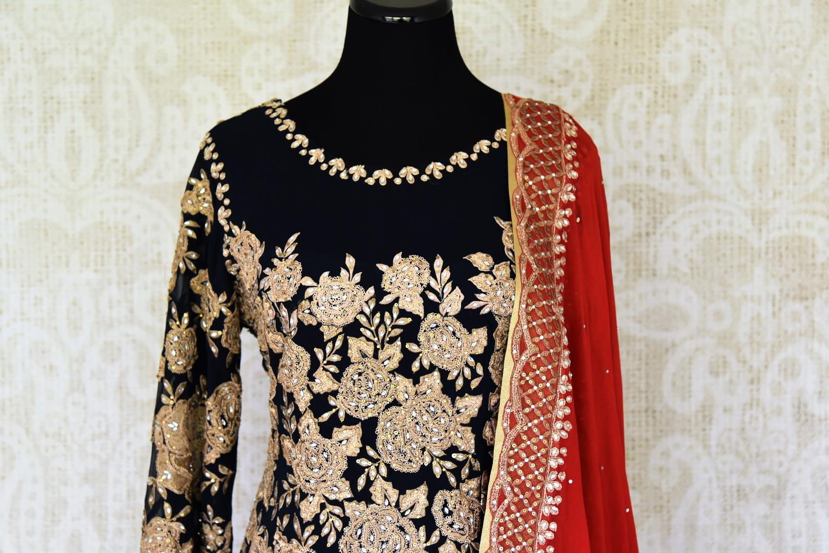 Buy beautiful black embroidered georgette suit online in USA with dupatta. If you are fond of Indian fashion then you must visit Pure Elegance Indian clothing store in USA. We have a splendid collection of Indian designer dresses, Indowestern dresses and clothing here for you on our shelves. -front
