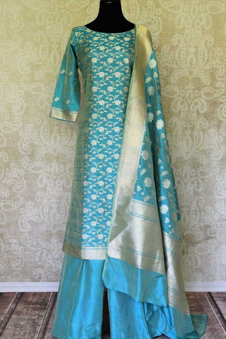 Buy light blue pure handloom Banarasi suit online in USA with dupatta. If you are fond of Indian fashion then you must visit Pure Elegance Indian clothing store in USA. We have a splendid collection of Indian designer dresses, Indowestern dresses and clothing here for you on our shelves. -full view