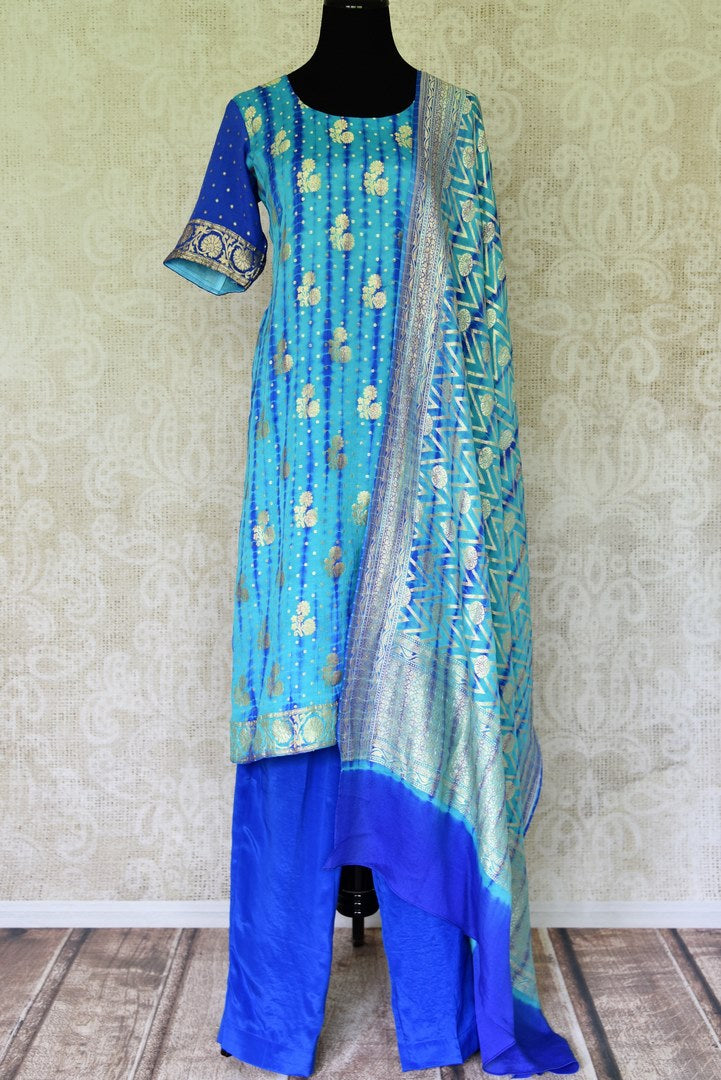 Buy turquoise blue Banarasi georgette salwar suit online in USA and dupatta from Pure Elegance Indian fashion store in USA. Make a stylish fashion statement this summer with a range of exquisite Indian designer dresses available online and at our clothing store in USA. Shop now.-full view