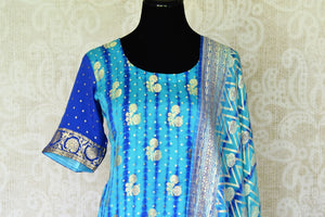 Buy turquoise blue Banarasi georgette salwar suit online in USA and dupatta from Pure Elegance Indian fashion store in USA. Make a stylish fashion statement this summer with a range of exquisite Indian designer dresses available online and at our clothing store in USA. Shop now.-front