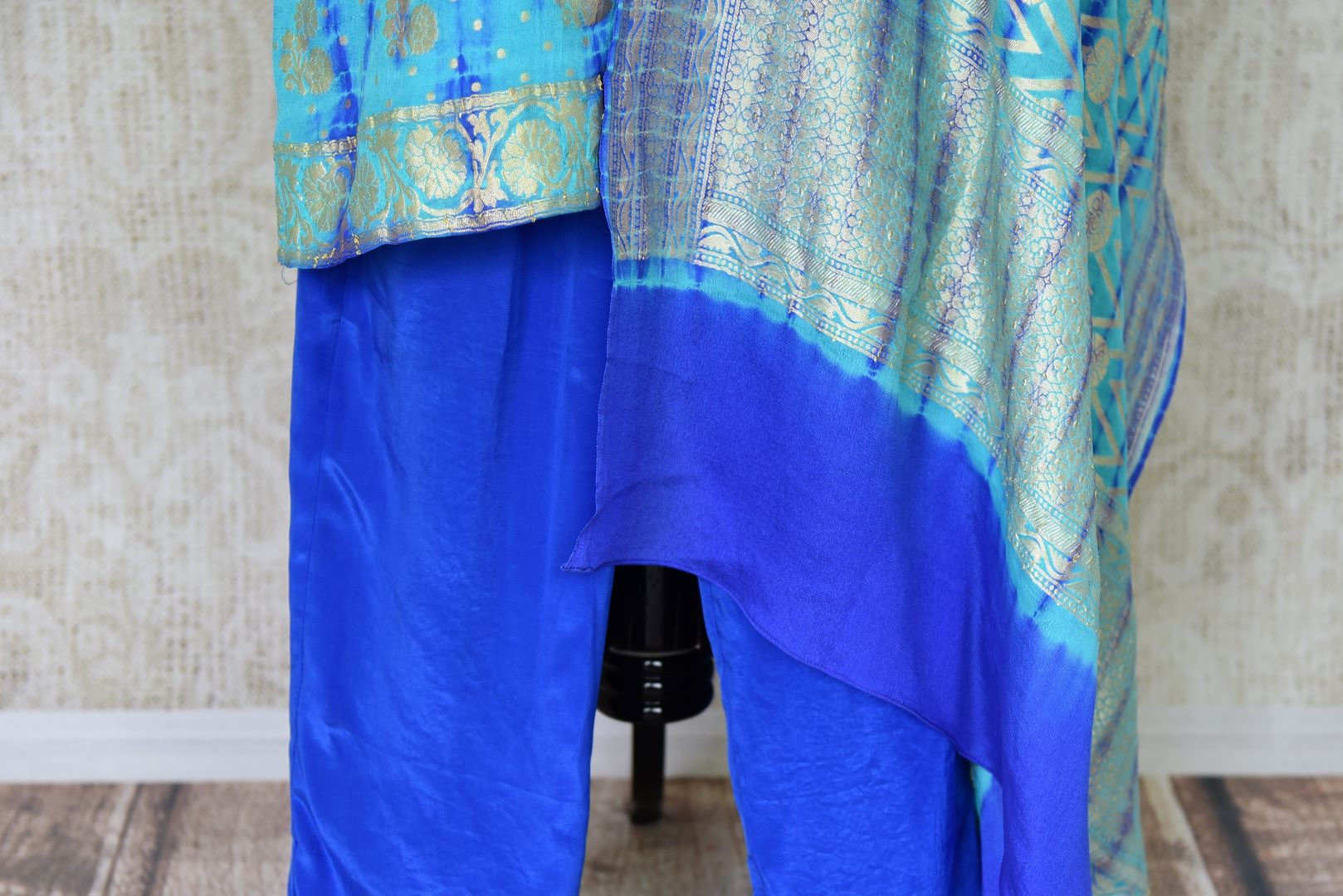 Buy turquoise blue Banarasi georgette salwar suit online in USA and dupatta from Pure Elegance Indian fashion store in USA. Make a stylish fashion statement this summer with a range of exquisite Indian designer dresses available online and at our clothing store in USA. Shop now.-bottom