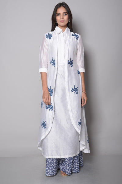Buy white embroidered cape and kurta with palazzo online in USA. The cape is adorned with beautiful dori work motifs which makes it so captivating. To buy more such exquisite designer suits in USA, shop at Pure Elegance Indian clothing store in USA or shop online.-full view