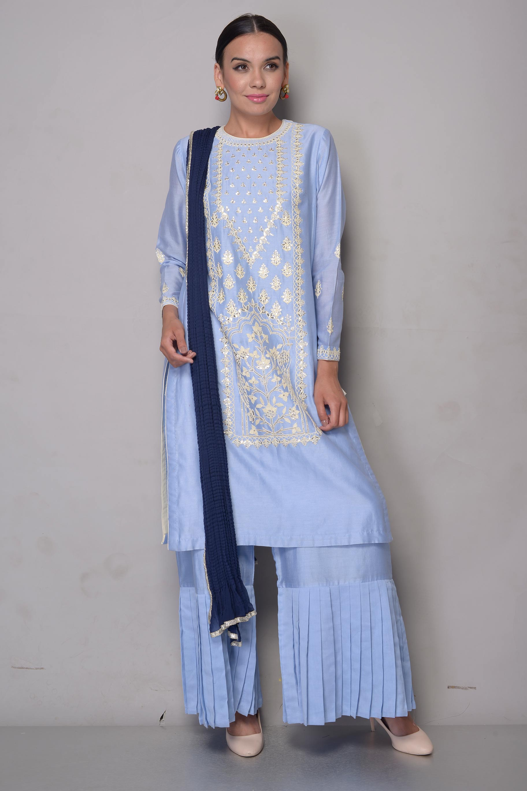 Buy sky blue gota patti chanderi suit with sharara online in USA and navy blue dupatta. To buy more such exquisite Indian designer suits in USA, shop at Pure Elegance Indian fashion store for women in USA or shop online.-full view