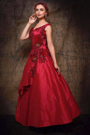 Shop rose red embroidered satin silk designer gown online in USA. Make your Indian look stylish with exquisite Indian designer dresses from Pure Elegance Indian clothing store for women in USA or shop online.-side view