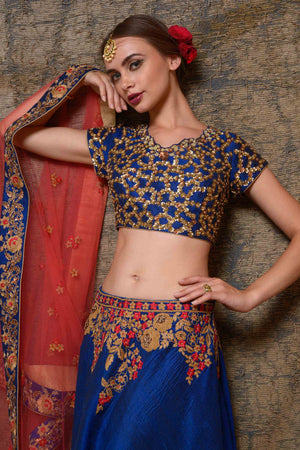 Buy blue raw silk embroidered lehenga online in USA with red net dupatta. Shine in rich silhouettes of exquisite Indian designer wedding lehengas from Pure Elegance Indian clothing store for women in USA or shop online.-blouse