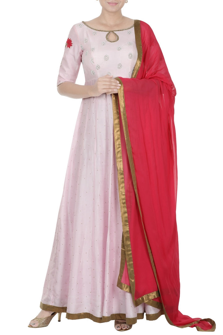 Shop pastel pink embroidered Anarkali suit online in USA with hot pink dupatta. Add elegance to your ethnic look with exquisite Indian designer suits, Anarkali suits available at Pure Elegance clothing store in USA or shop online.-full view