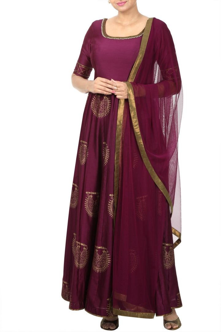 Shop magenta block printed and embroidered Anarkali suit online in USA with net dupatta. Add elegance to your ethnic look with exquisite Indian designer suits, Anarkali suits available at Pure Elegance clothing store in USA or shop online.-full view