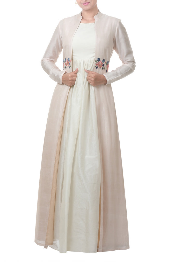 Buy elegant light peach jacket and ivory white dress online in USA. Bring glamor to your Indian style with exquisite Indian designer suits, Anarkali suits, Indian dresses available at Pure Elegance clothing store in USA or shop online.-full view