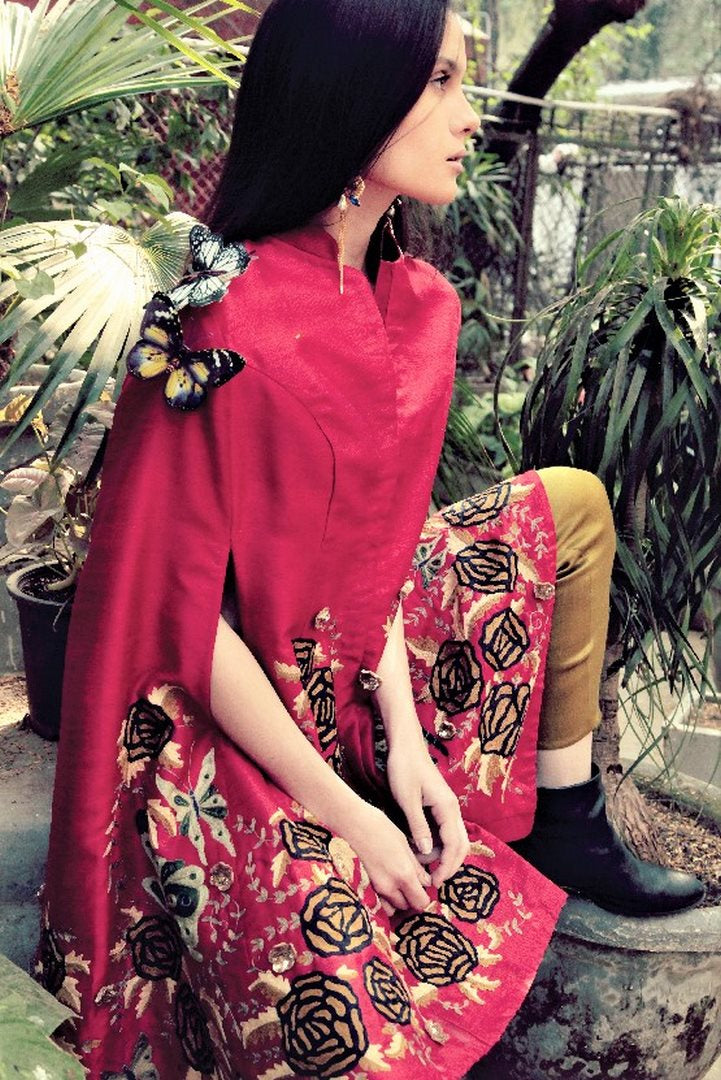 Buy dark red embroidered silk butterfly front open cape with pants online in USA. Stay updated with latest trends and styles with designer dresses, gowns, Indowestern dresses from Pure Elegance clothing store in USA or shop online.-sitting pose