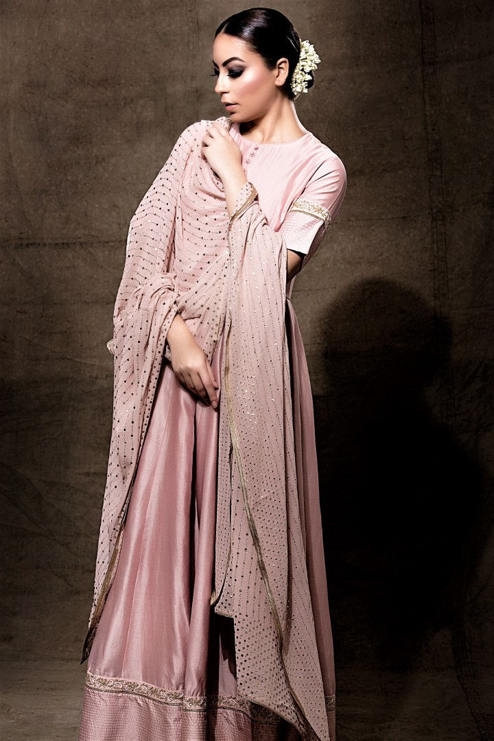 op blush pink embroidered chanderi Anarkali online in USA with dupatta. Shine with rich ethnic outfits at weddings and special occasions from Pure Elegance clothing store in USA. An exquisite collection of Indian designer dresses, wedding sarees, party dresses, and much more is waiting for you on online and in our store.-full view