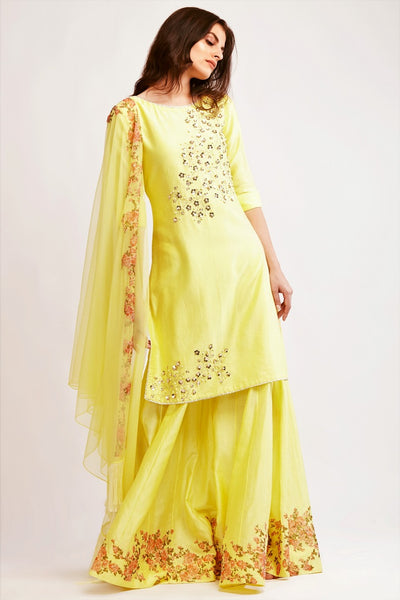 Buy pale yellow chanderi pearl work kurta with sharara online in USA. You can find a fine collection of Indian designer dresses in USA at Pure Elegance clothing store. Our range of traditional Indian clothing, designer silk saris, designer suits,  at our online store is sure to leave you awestruck. -full view